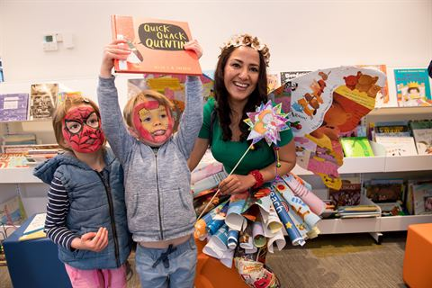 Photo of Newport Community Hub Open Day Fairy and Children with their faces painted holding books in the library